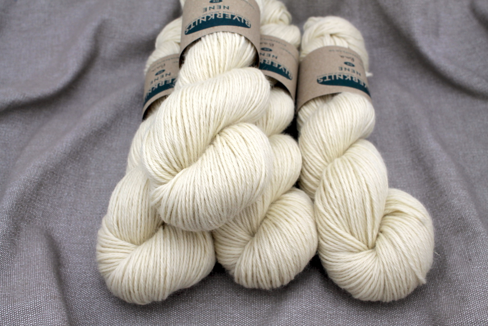 A pile of un-dyed ecru skeins