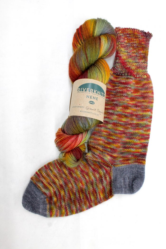 A knitted sock in the Giant Squirrel colourway