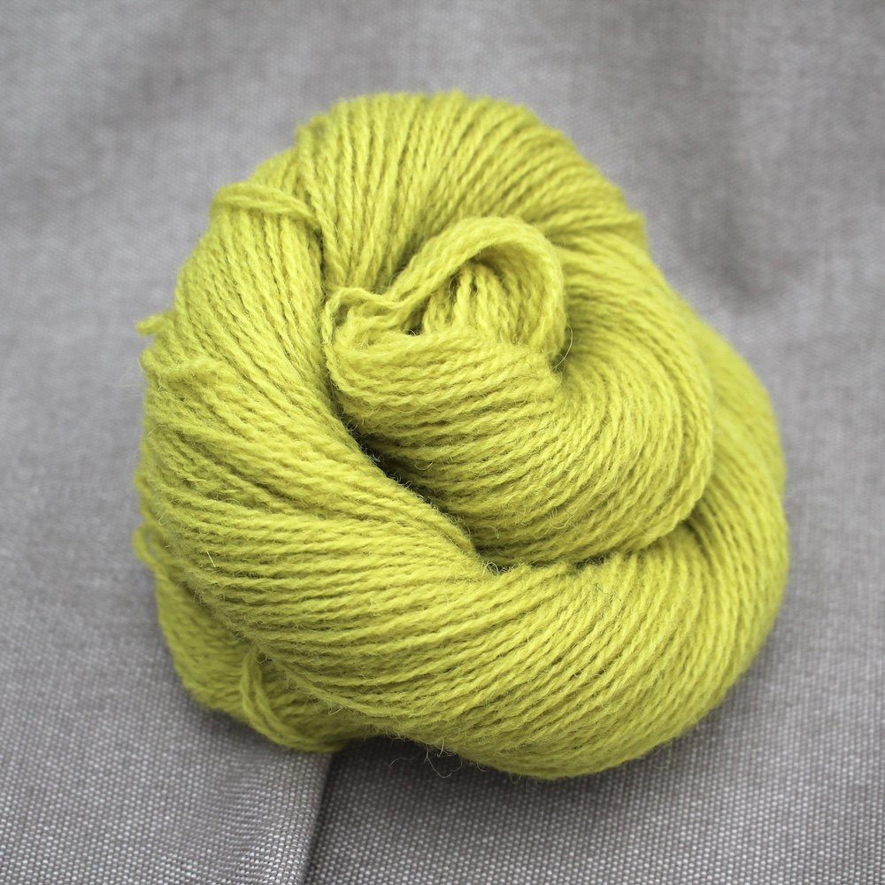 A skein of Severn 4 Ply in a chartreuse colour