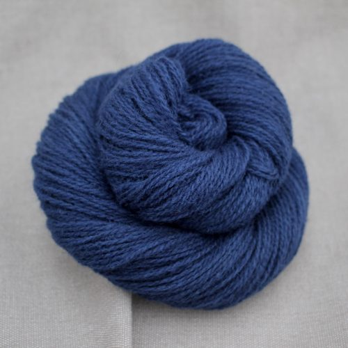 A skein of Severn 4 Ply in dark navy blue