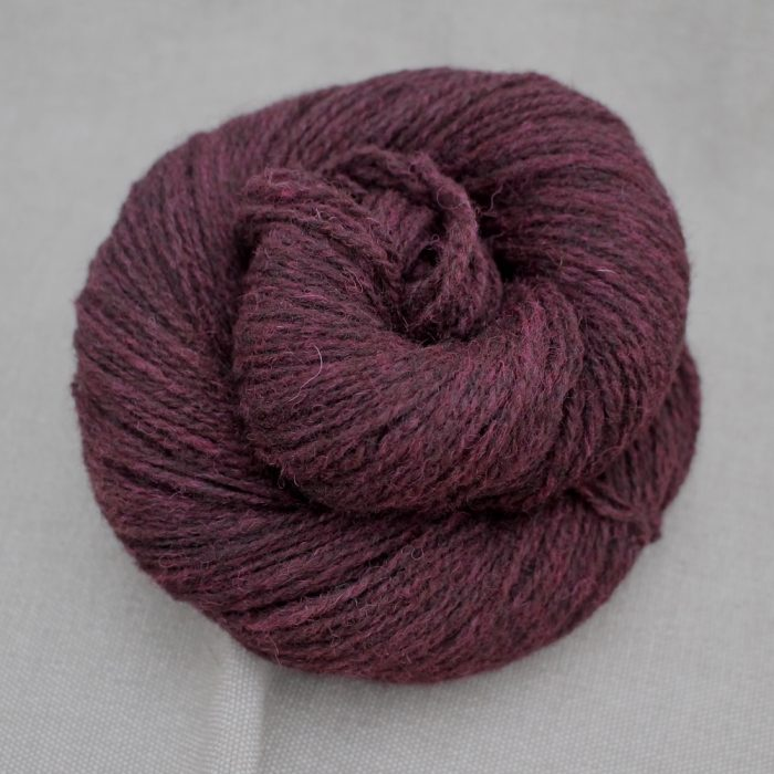 A skein of Severn 4 Ply in a deep wine red colour