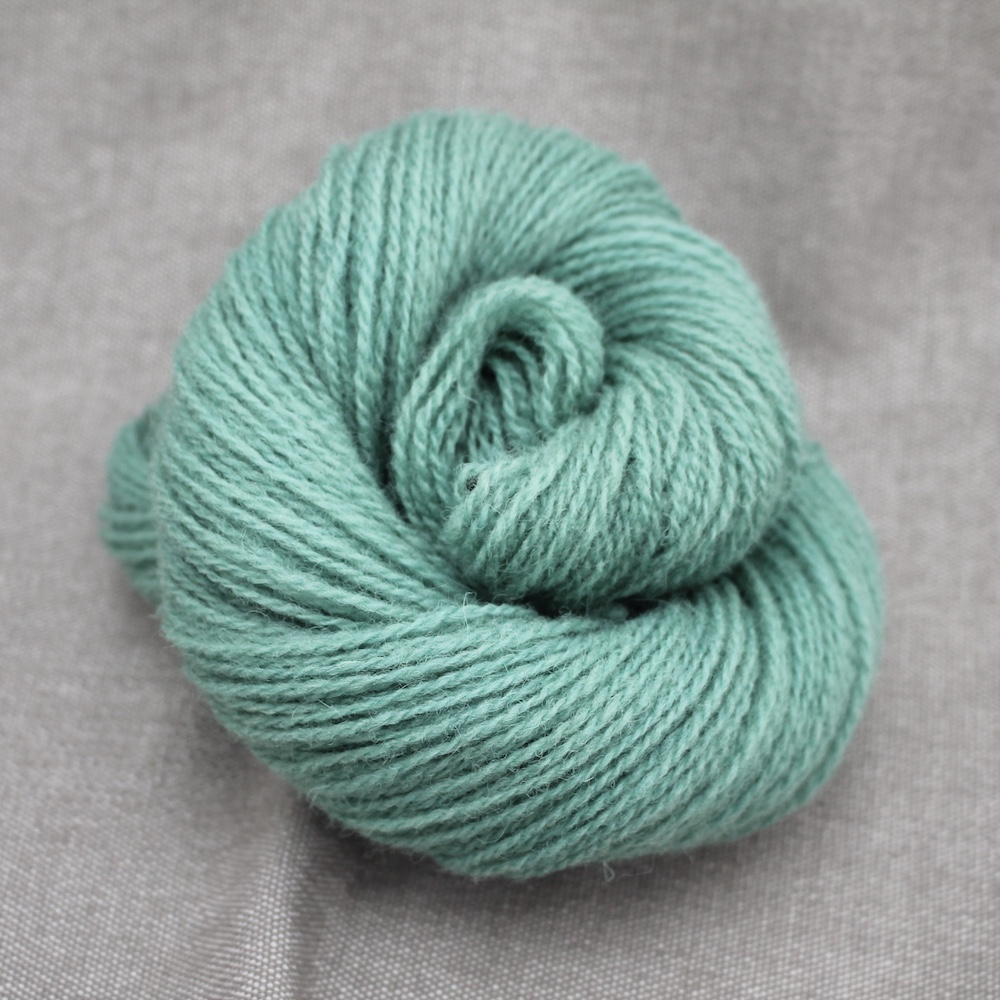 A skein of Severn 4 Ply in a pale teal colour