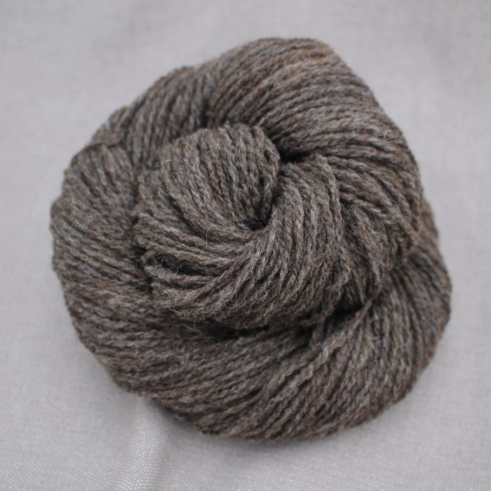 A skein of Severn 4 Ply in a naturally heathered brown colour