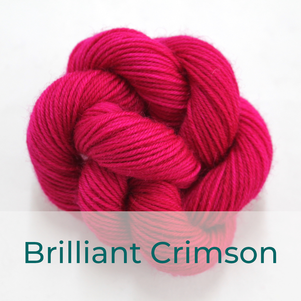 BFL 4 Ply mini skein in Brilliant Crimson colourway. It is bright pink.