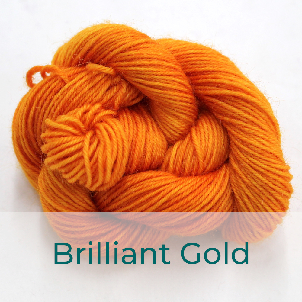 BFL 4 Ply mini skein in Brilliant Gold colourway. It is bright orange-yellow.