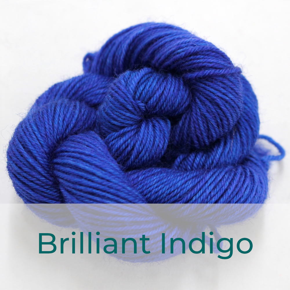 BFL 4 Ply mini skein in Brilliant Indigo colourway. It is bright blue.