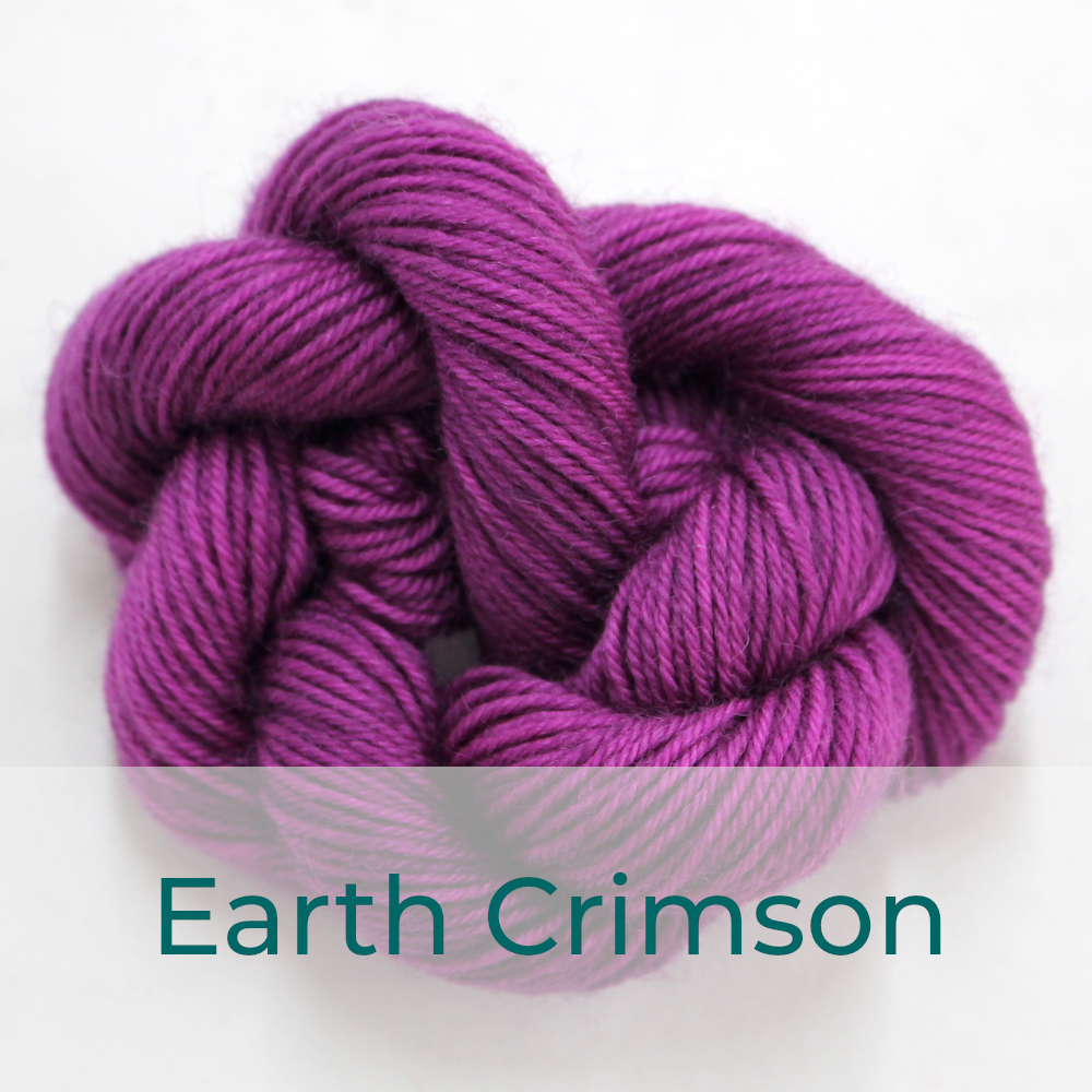 BFL 4 Ply mini skein in Earth Crimson colourway. It is a dusky pink / purple.