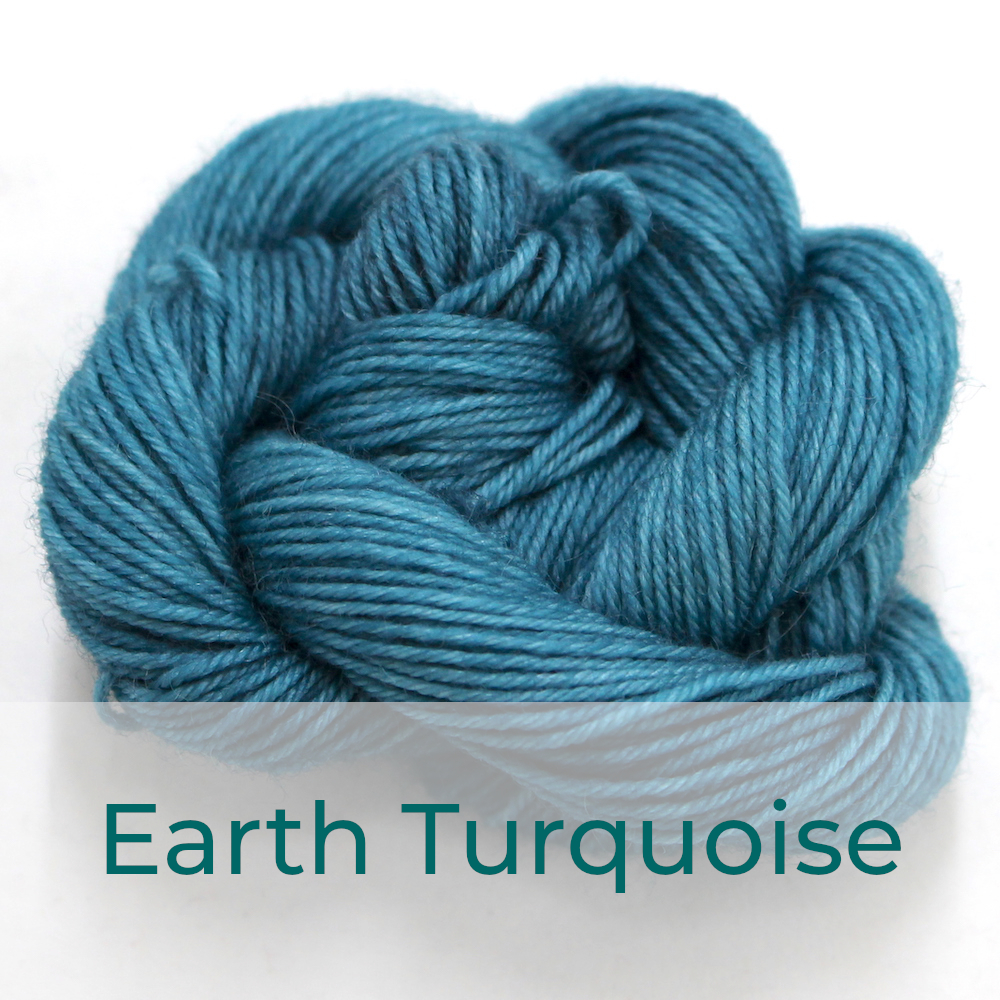 BFL 4 Ply mini skein in the Earth Turquoise colourway. It is a soft muted turquoise colour.