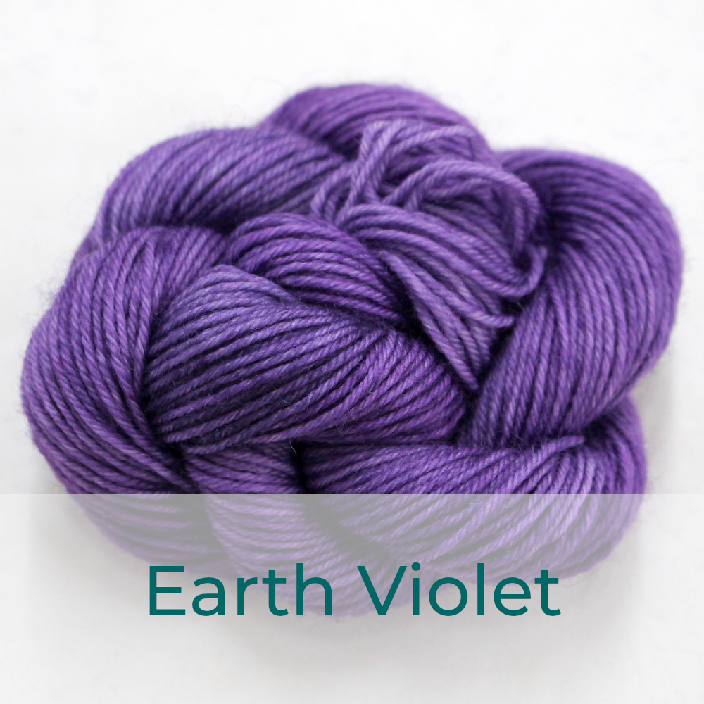 BFL 4 Ply mini skein in the Earth Violet colourway. It is dusky violet purple.