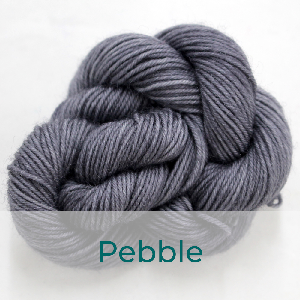 BFL 4 Ply mini skein in the Pebble colourway. It is mid grey.