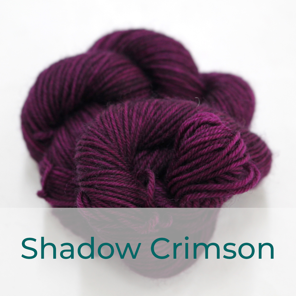 BFL 4 Ply mini skein in Shadow Crimson colourway. It is dark plum / purple.