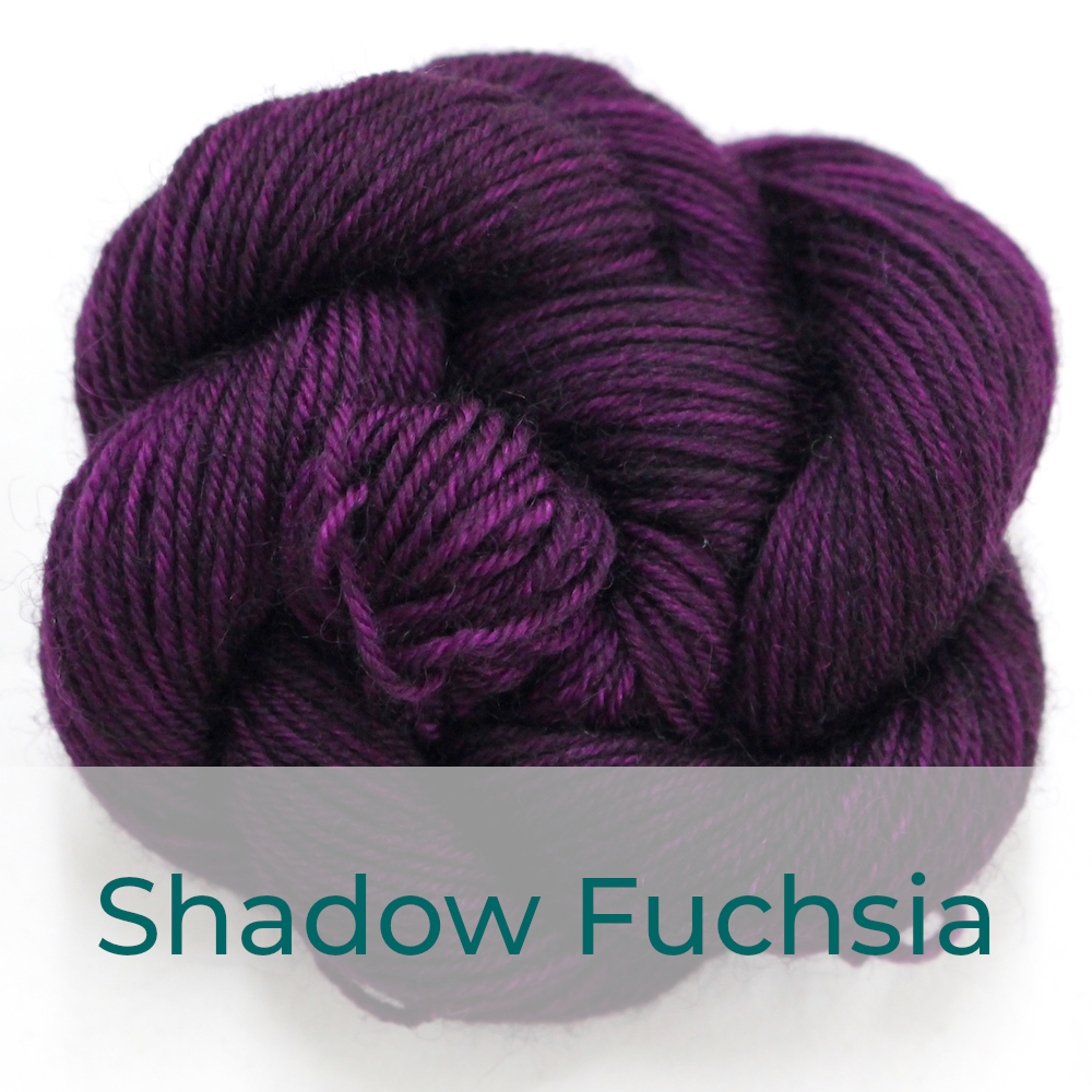 BFL 4 Ply mini skein in Shadow Fuchsia colourway. It is dark fuchsia purple.