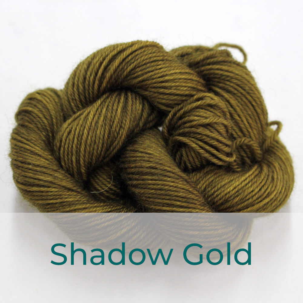 BFL 4 Ply mini skein in the Shadow Gold colourway. It is dark green-brown.