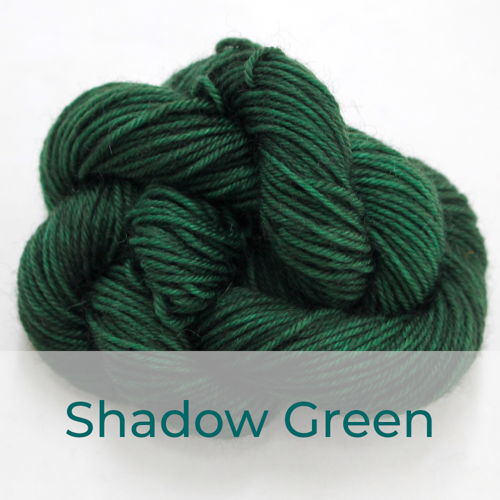 BFL 4 Ply mini skein in Shadow Green colourway. It is dark forest green.