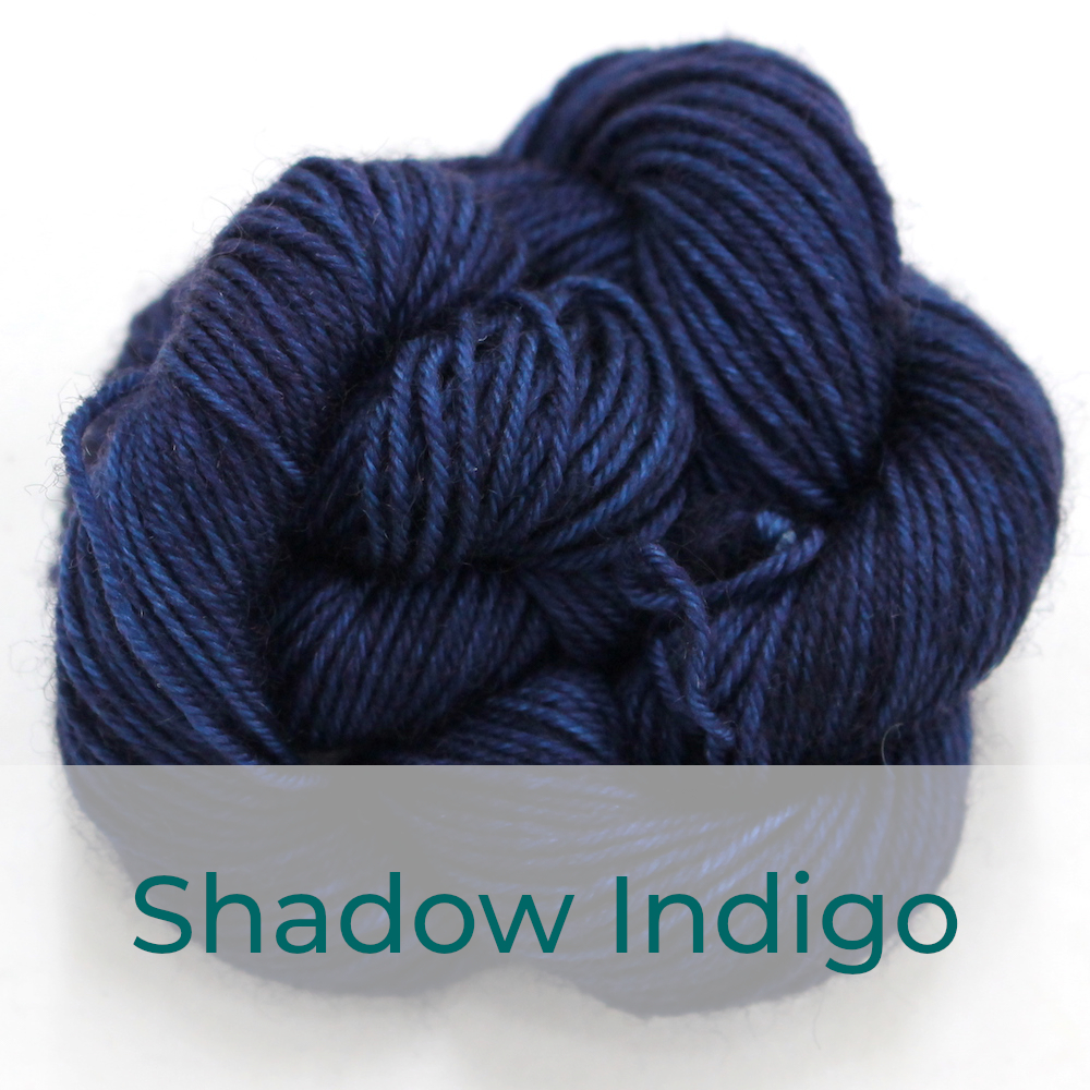 BFL 4 Ply mini skein in the Shadow Indigo colourway. It is navy blue.