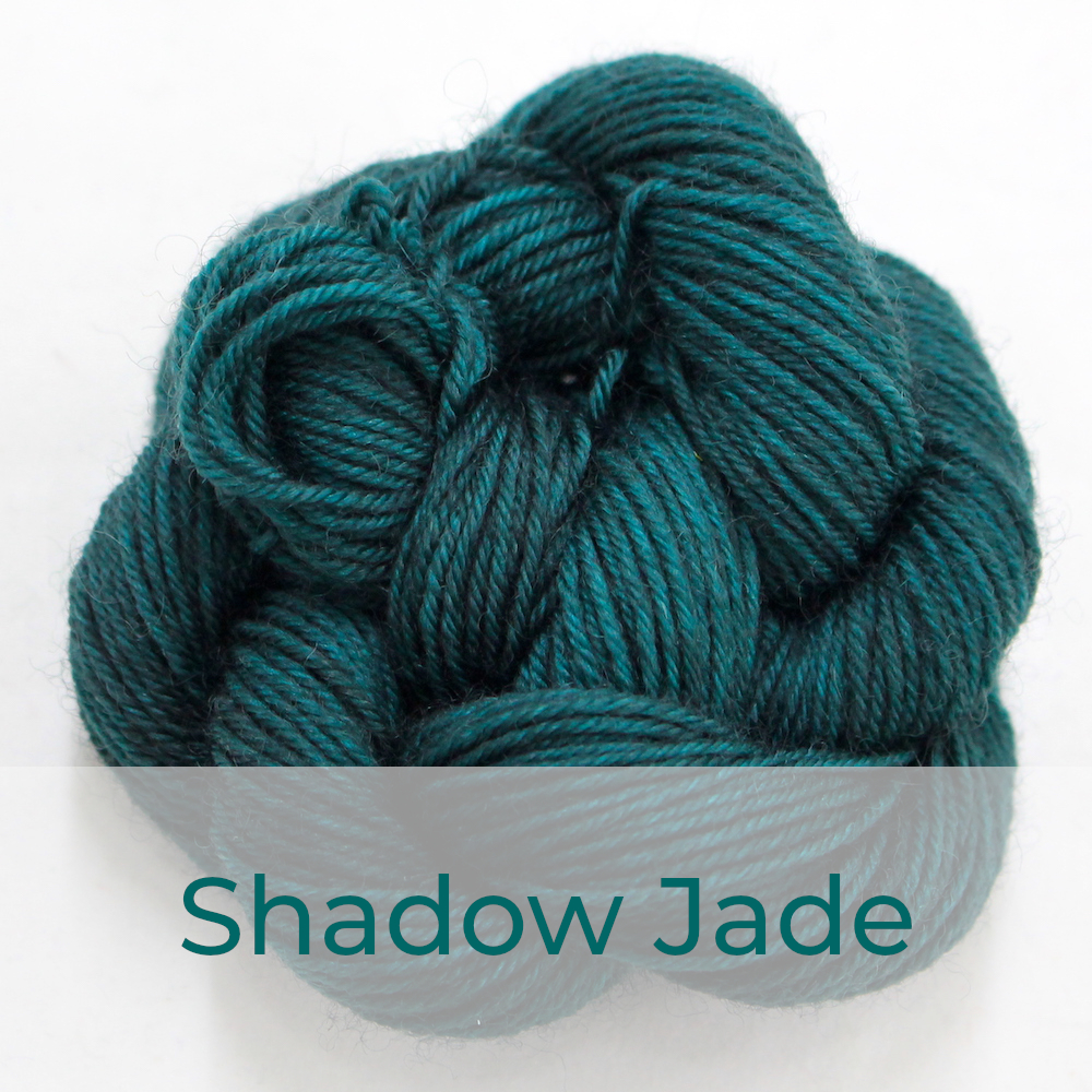 BFL 4 Ply mini skein in Shadow Jade colourway. It is dark jade green.