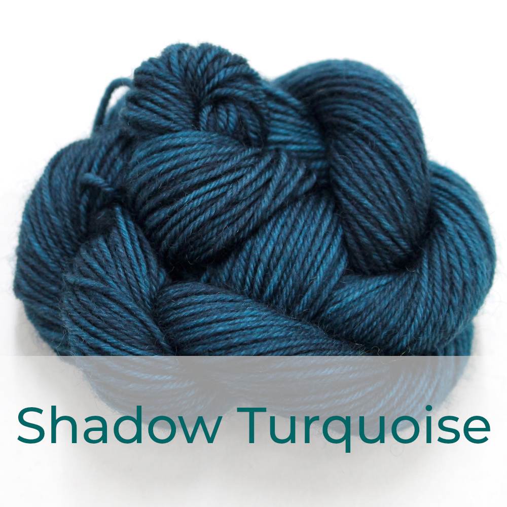 BFL 4 Ply mini skein in Shadow Turquoise colourway. It is dark petrol blue.