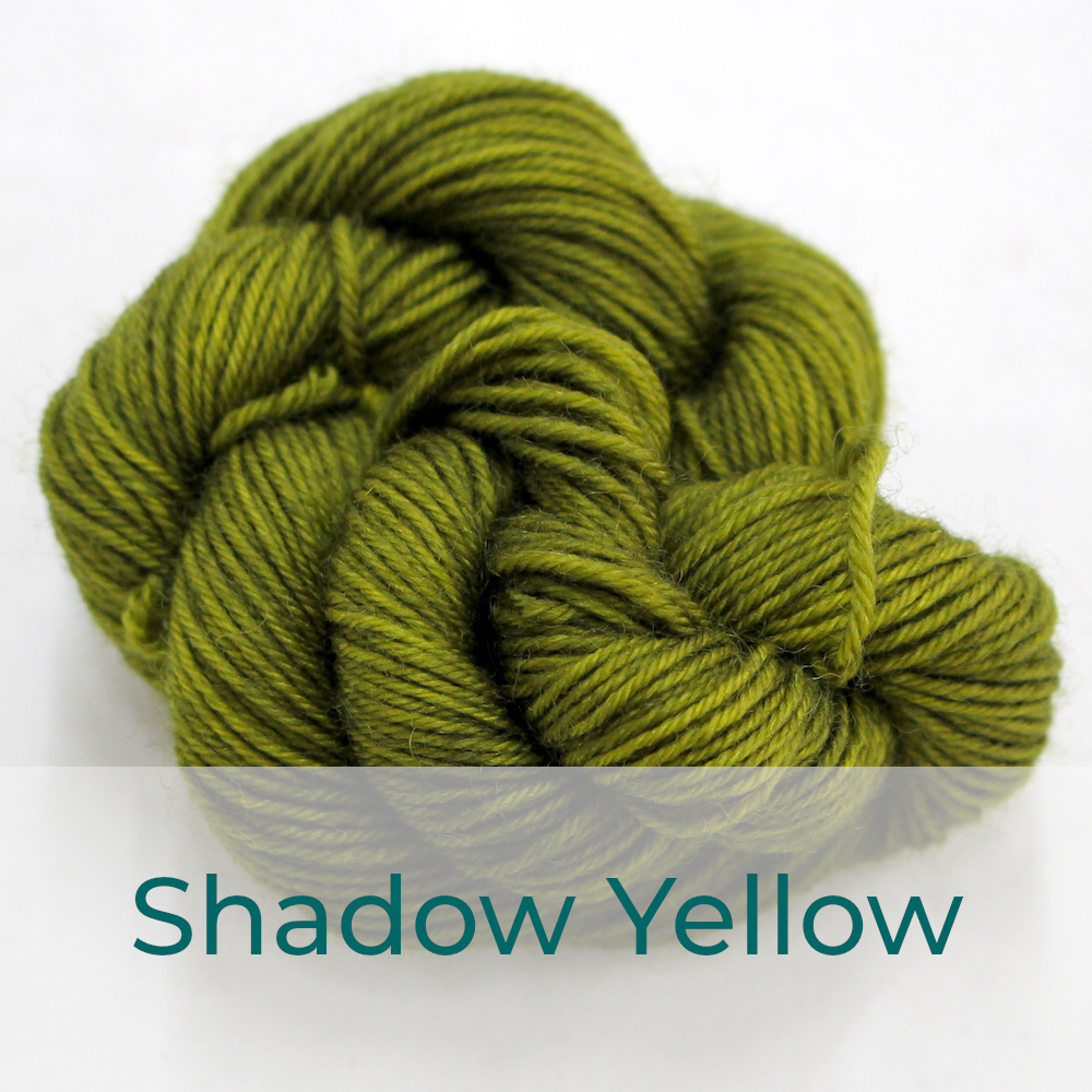 BFL 4 Ply mini skein in Shadow Yellow colourway. It is dark green-brown.