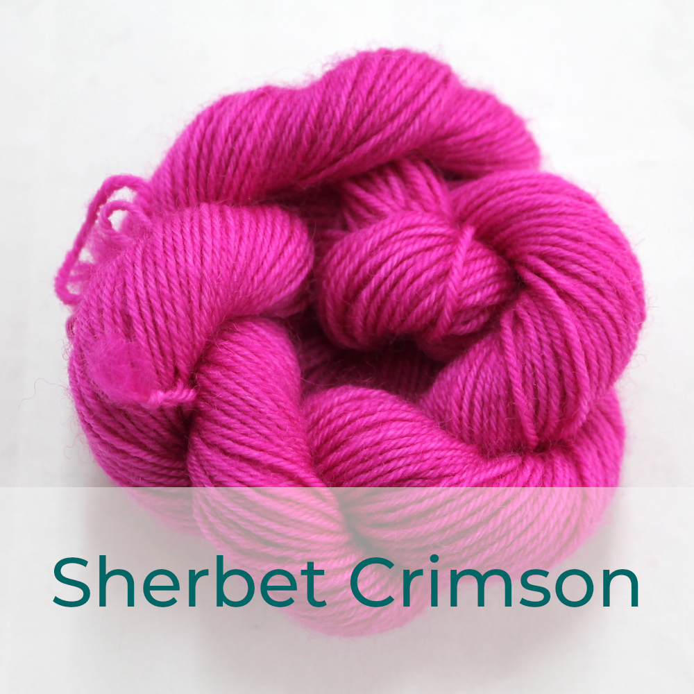 BFL 4 Ply mini skein in Sherbet Crimson colourway. It is bright pink.