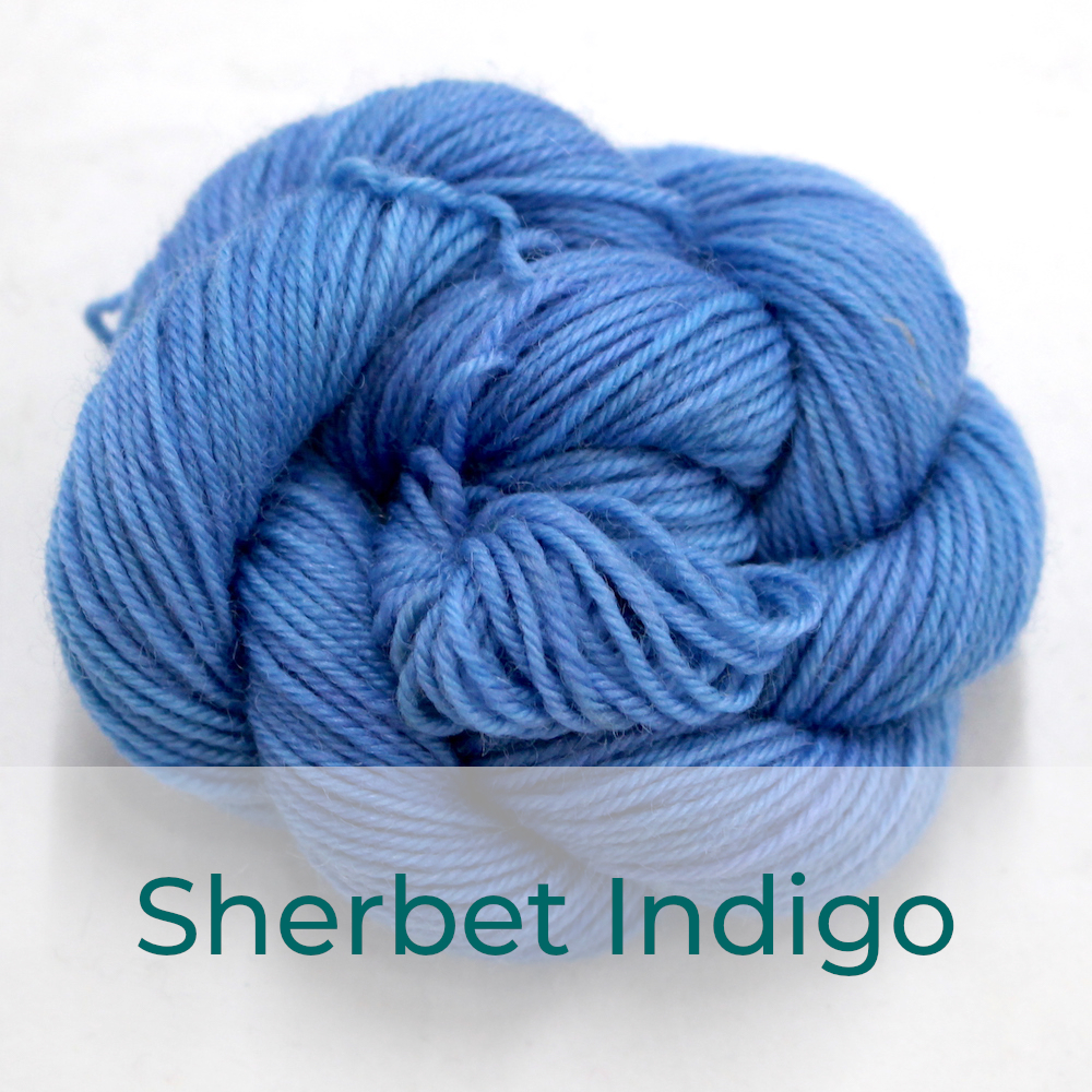 BFL 4 Ply mini skein in Sherbet Indigo colourway. It is light blue.