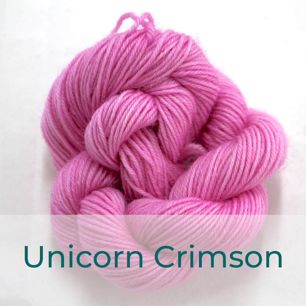 BFL 4 Ply mini skein in Unicorn Crimson colourway. It is light pink.