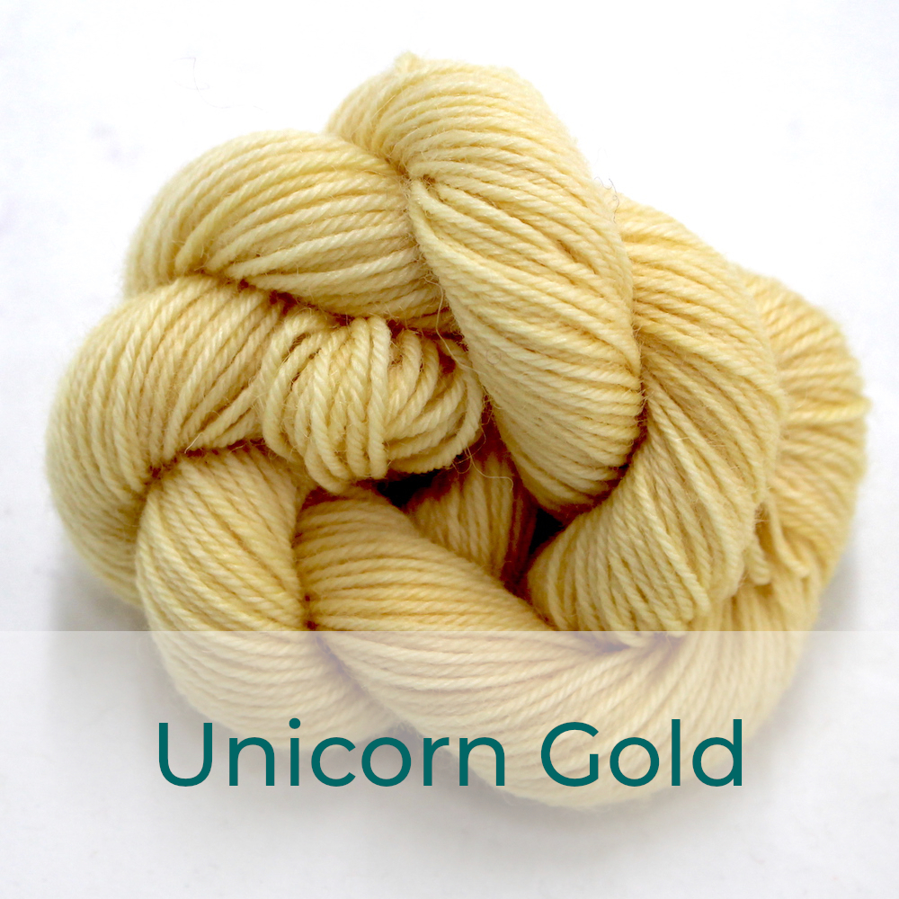 BFL 4 Ply mini skein in the Unicorn Gold colourway. It is a light buttery yellow.