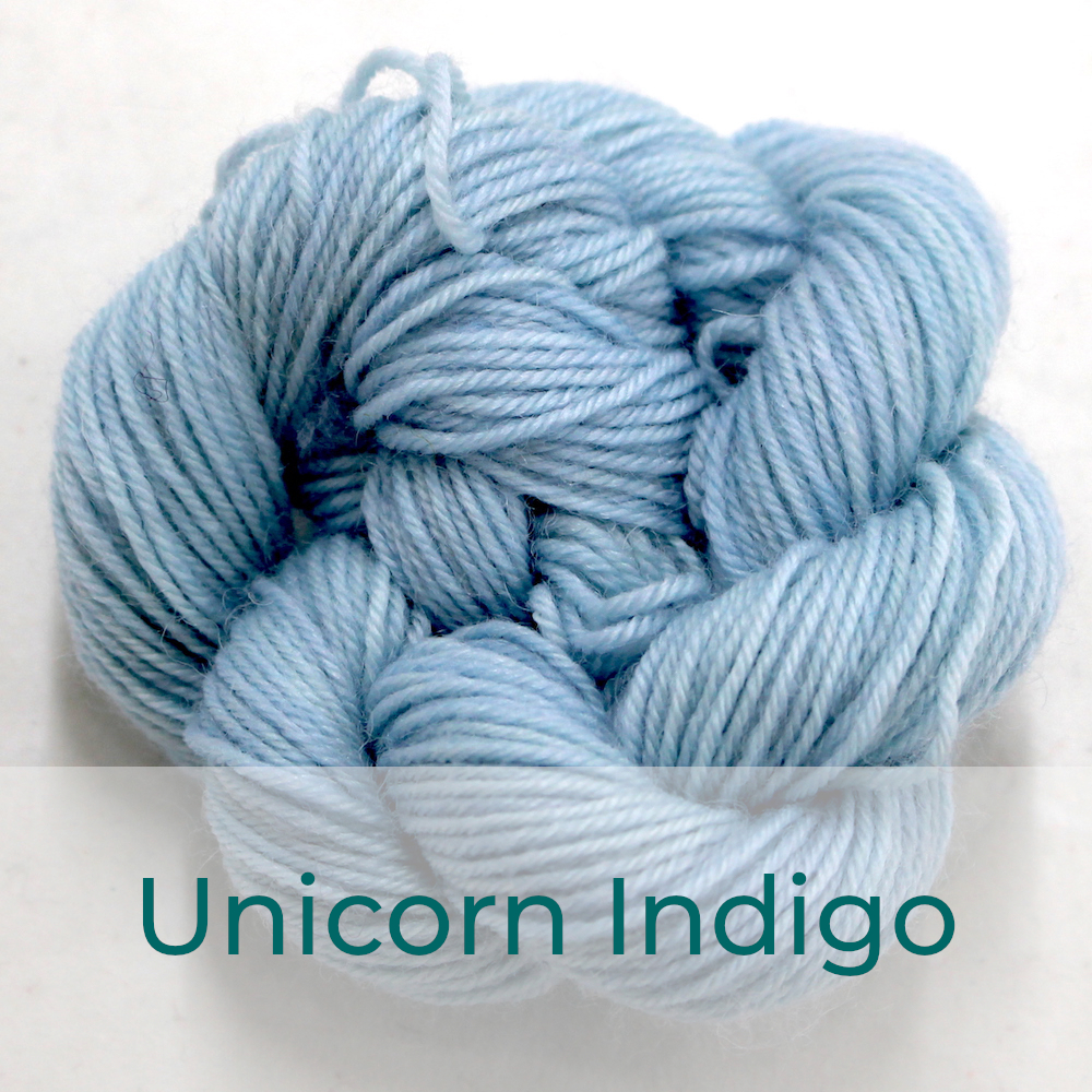 BFL 4 Ply mini skein in the Unicorn Indigo colourway. It is very light blue.