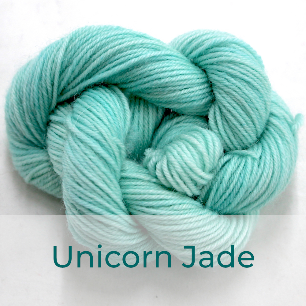 BFL 4 Ply mini skein in the Unicorn Jade colourway. It is spearmint green.