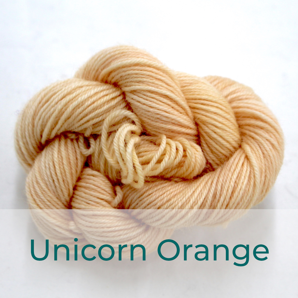 BFL 4 Ply mini skein in the Unicorn Orange colourway. It is light peach coloured.
