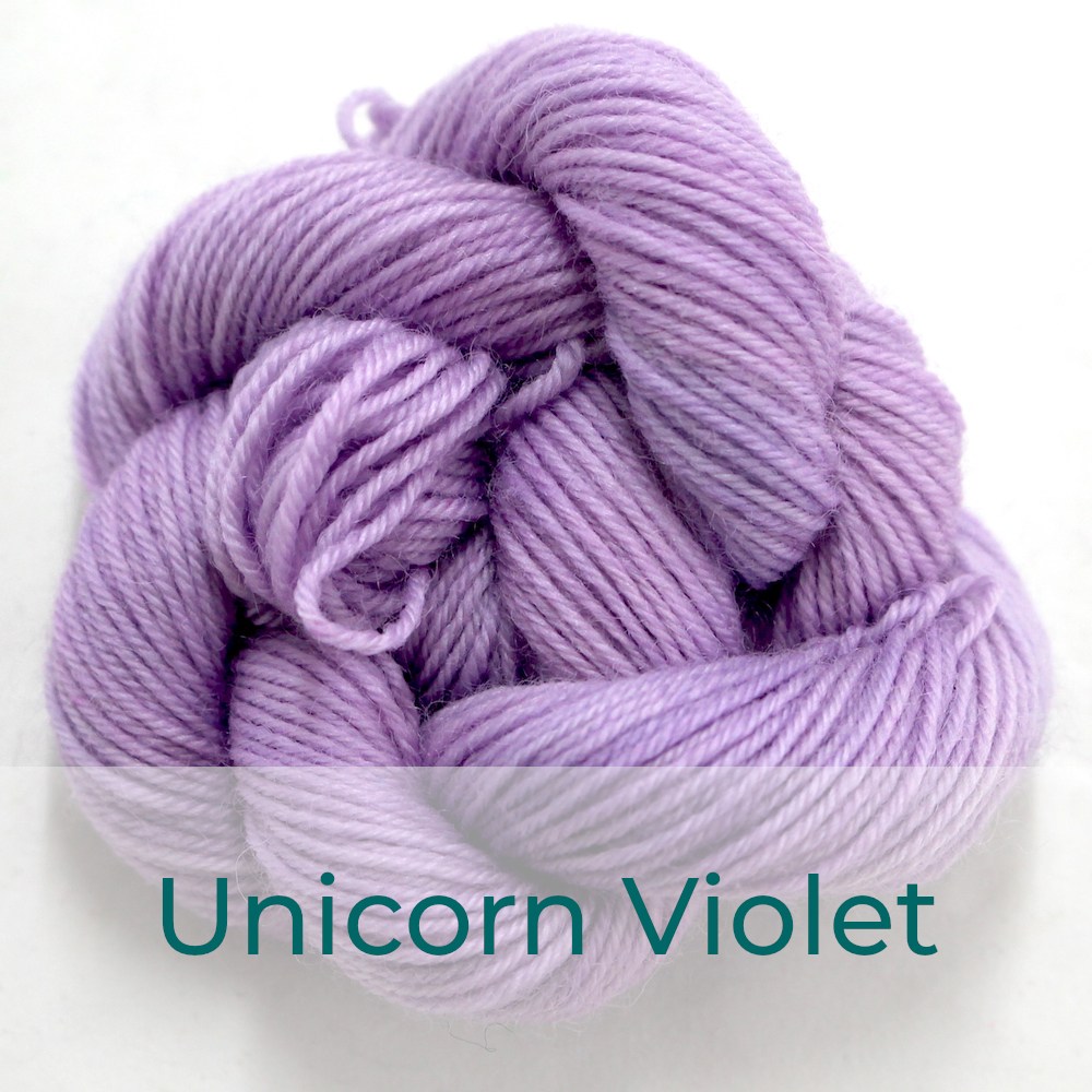 BFL 4 Ply mini skein in the Unicorn Violet colourway. It is very light purple.