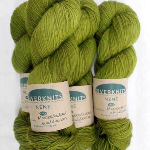 A pile of skeins of Nene 4 Ply in olive mossy green
