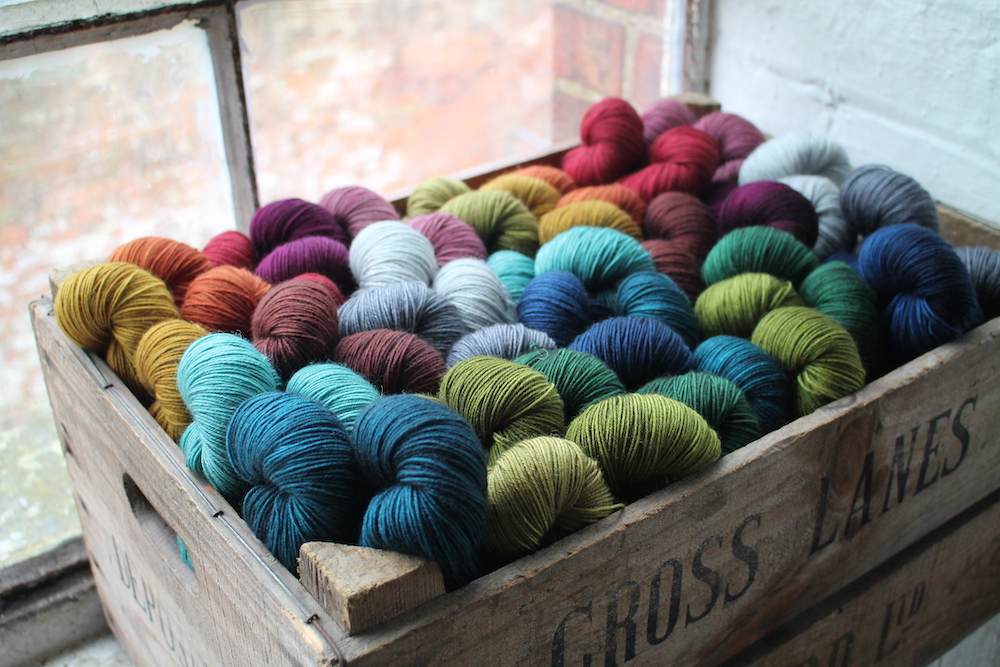 BFL 4 Ply skeins in a crate