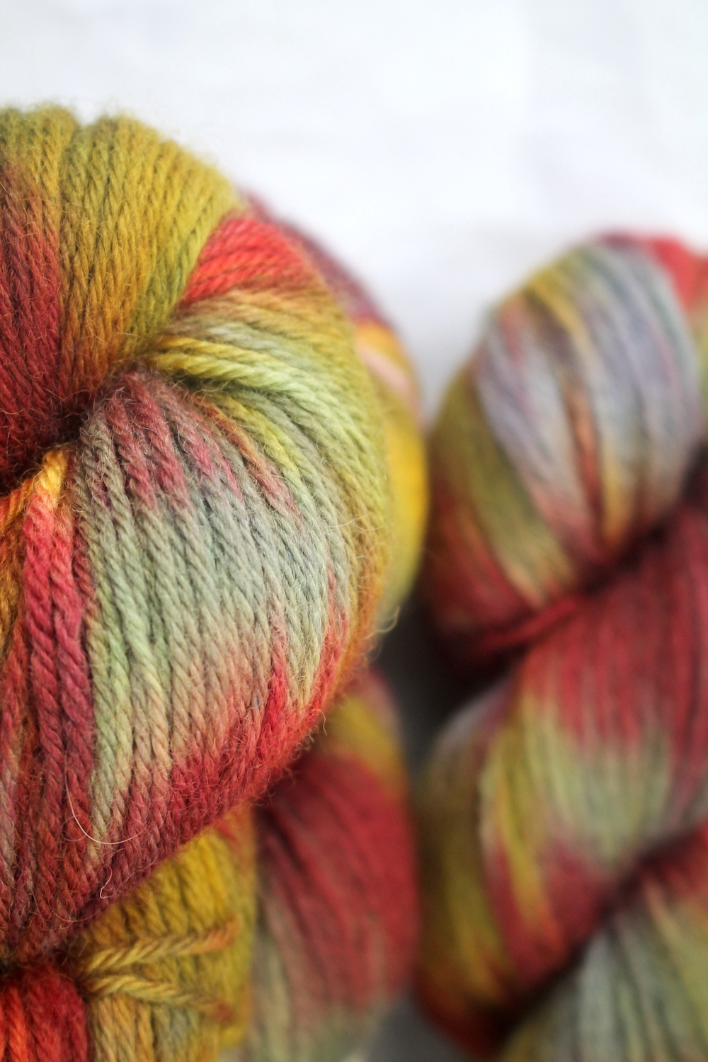 Skeins of Giant Squirrel - in burnt reds, oranges, mustard, and grey