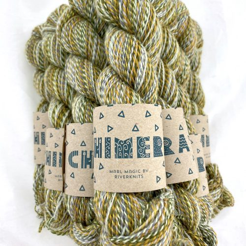 A pile of marled yarn in mint and khaki green, mustard, and mid greys.