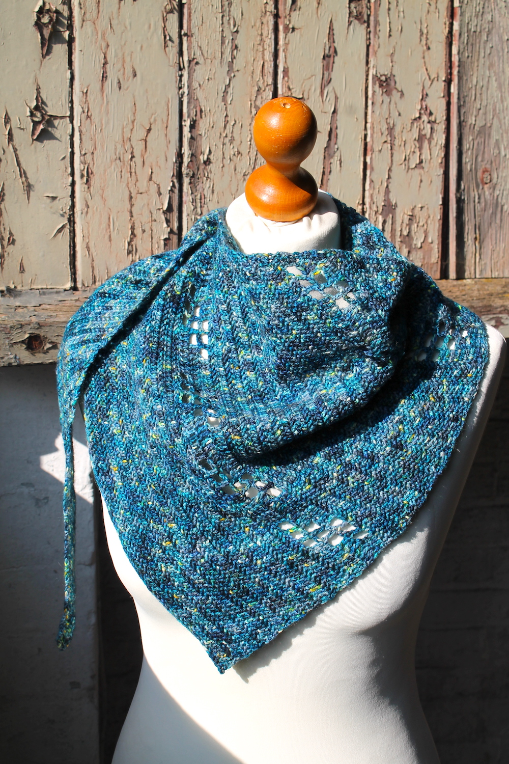 The Omni shawl shown in the Starry Night colourway, draped on a mannequin.