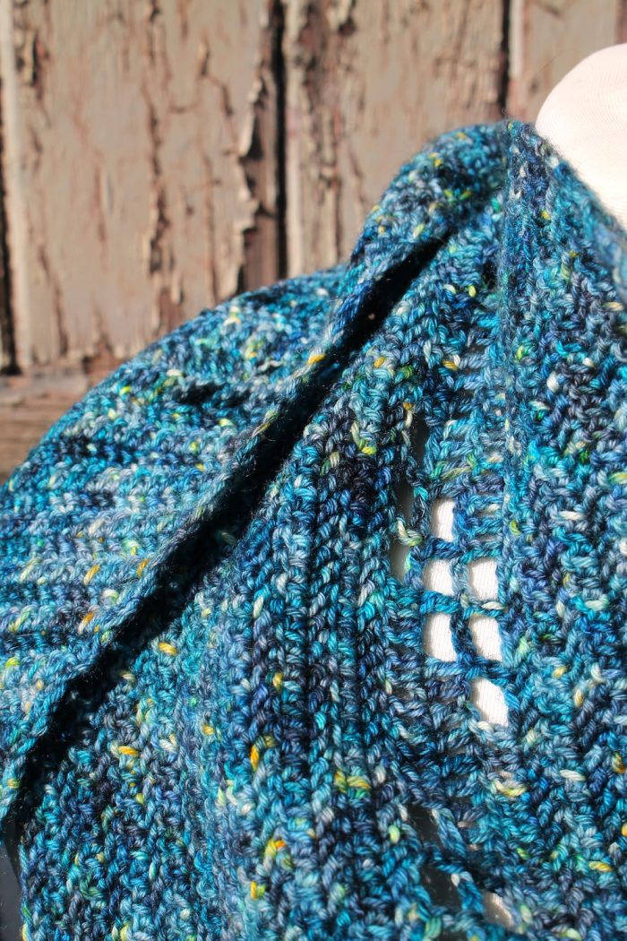 Close up of the lace holes in the Omni Shawl