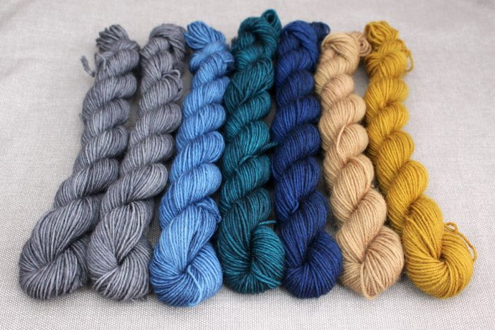 7 mini skeins in greys, blues, and golds