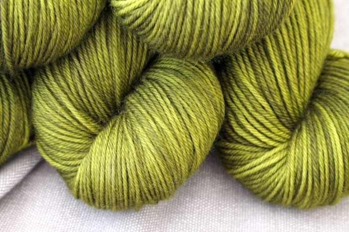 A close up of the Moosbedeckter Waldboden colourway. It is a mossy, olive green.