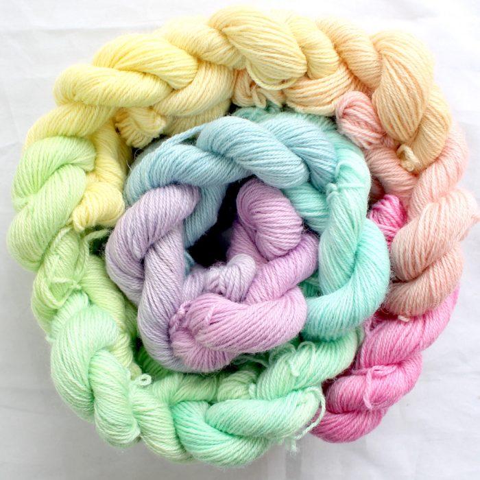 12 mini skeins in a pastel rainbow