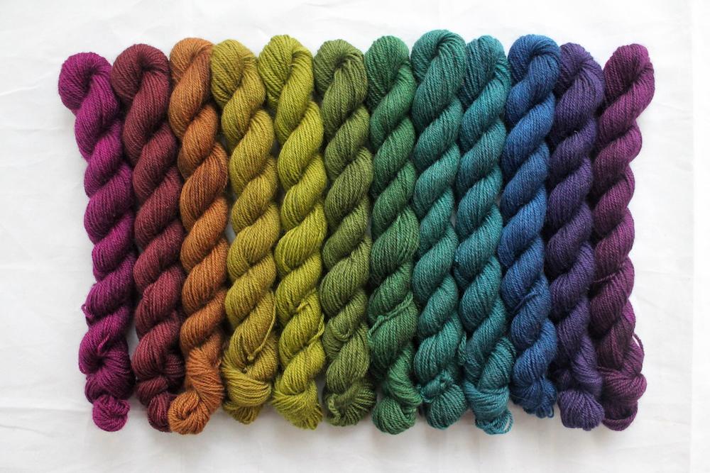 12 mini skeins in a dark toned rainbow