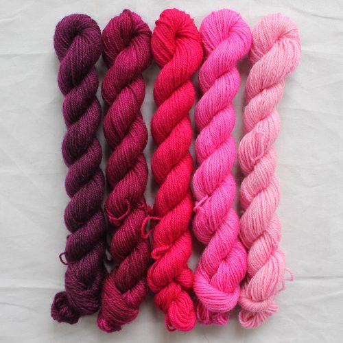 5 crimson mini skeins in a gradient from dark to light