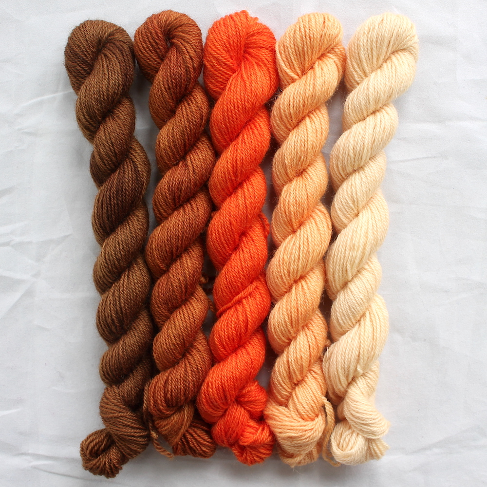 5 orange mini skeins in a gradient from dark to light