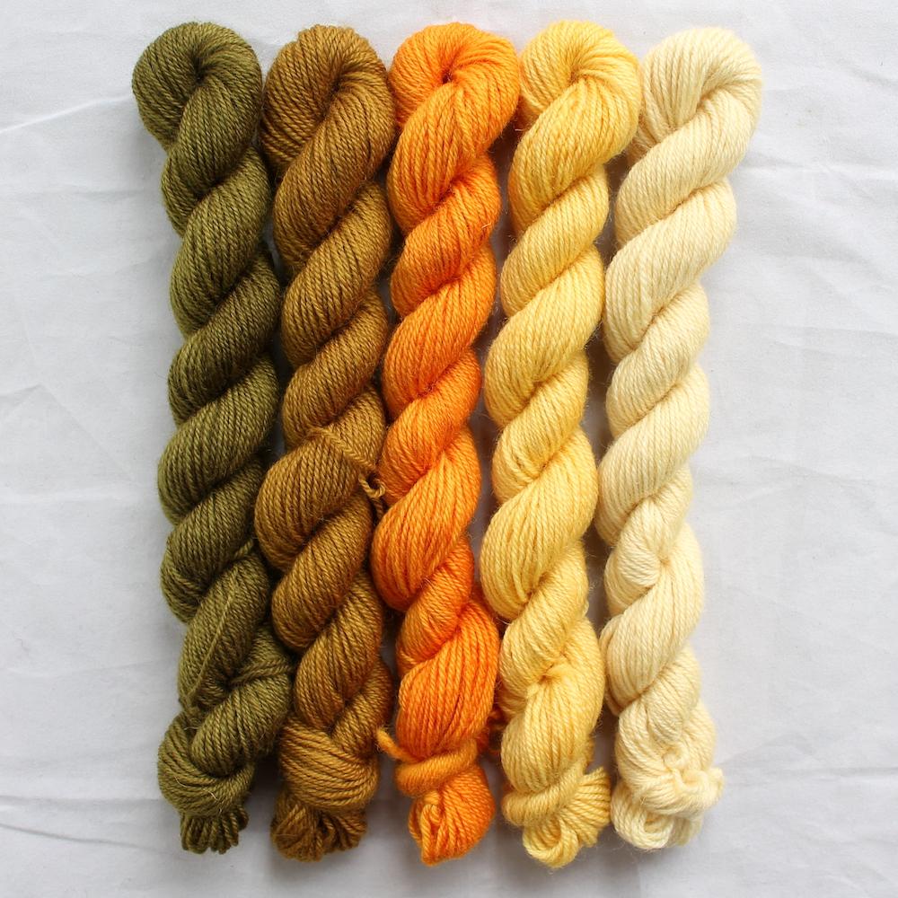 5 golden yellow mini skeins in a gradient from dark to light