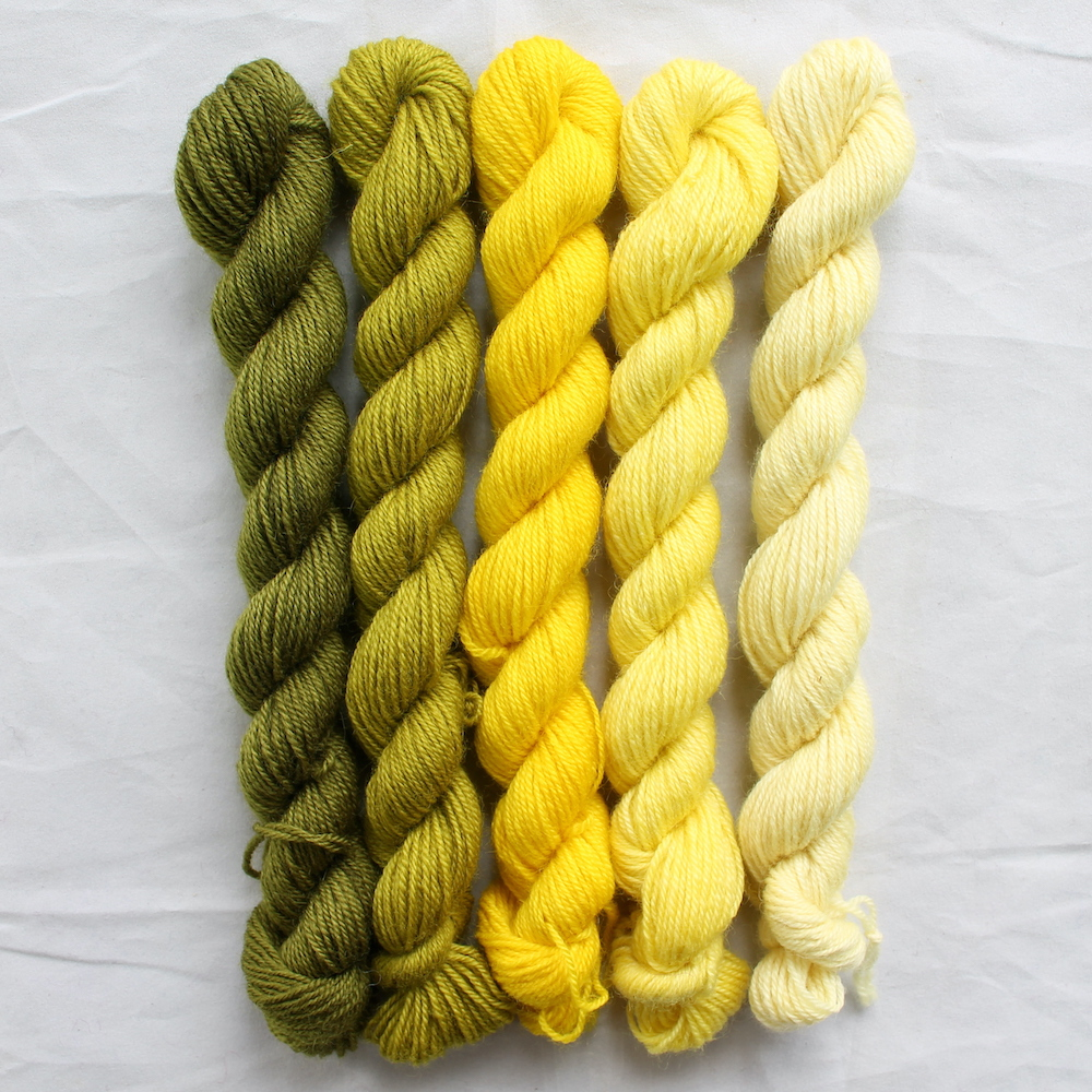 5 yellow mini skeins in a gradient from dark to light
