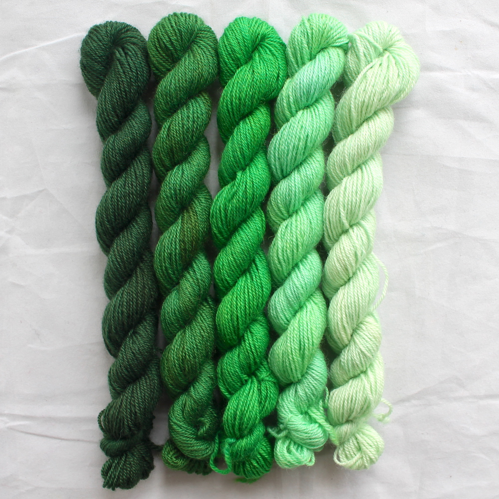 5 green mini skeins in a gradient from dark to light