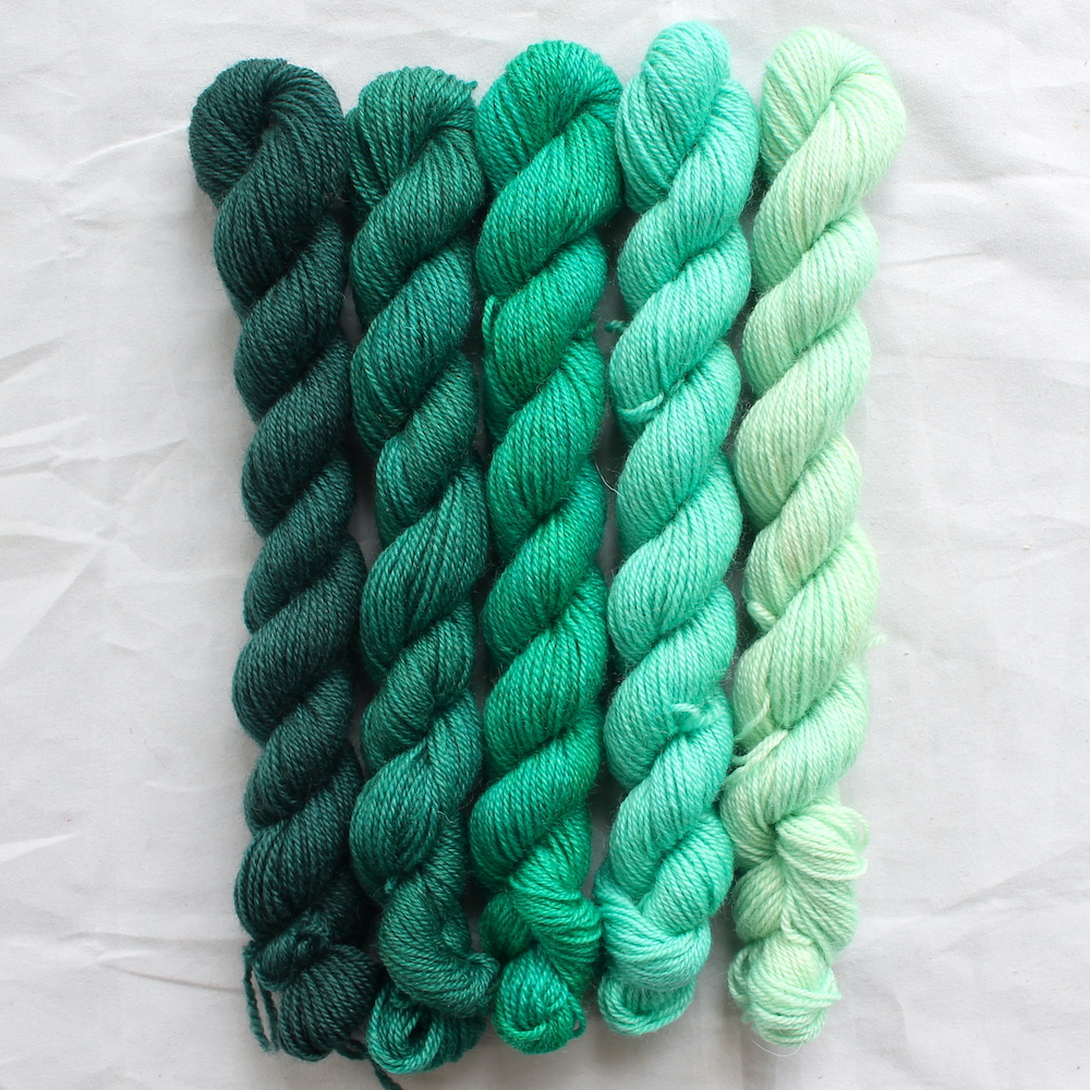 5 jade green mini skeins in a gradient from dark to light