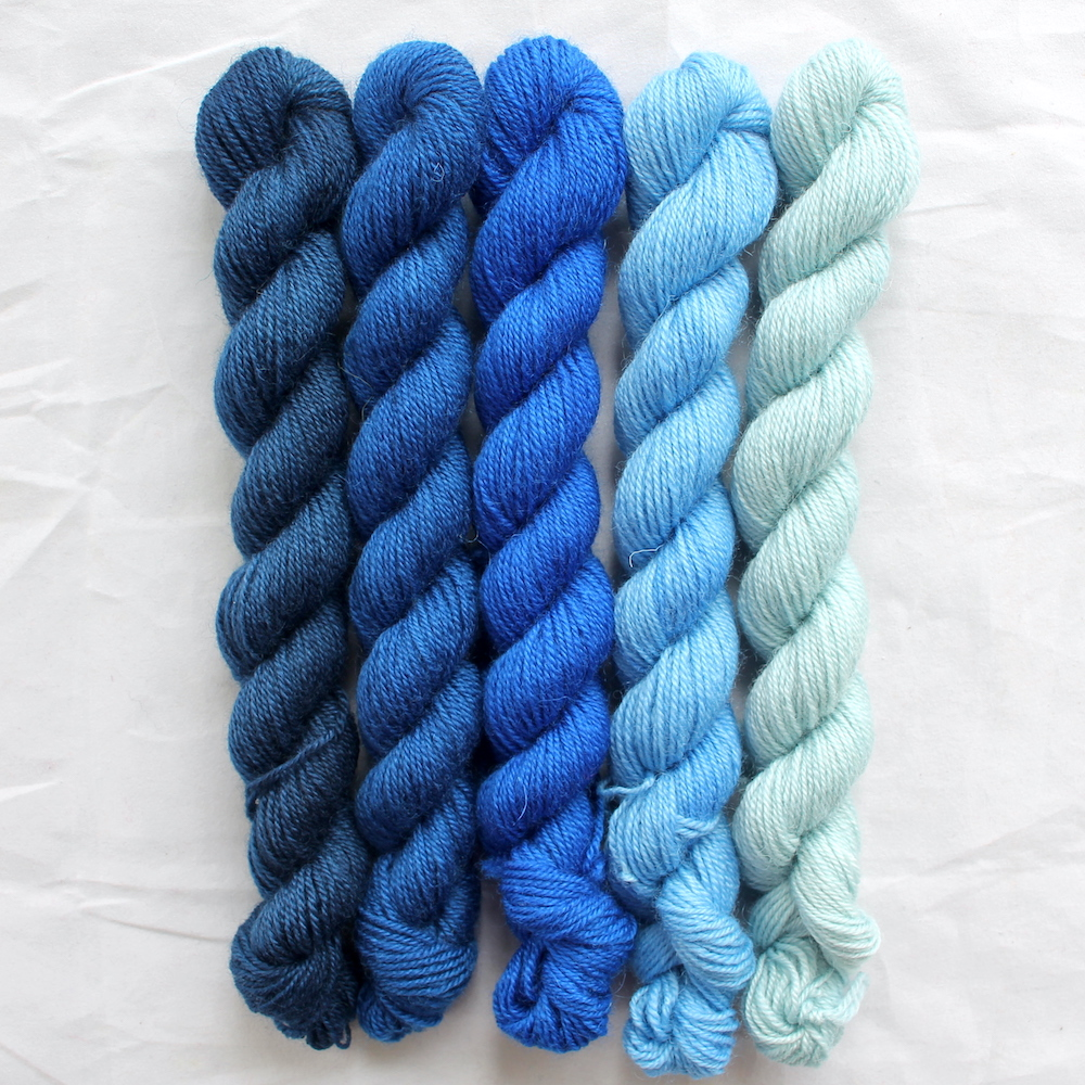 5 blue mini skeins in a gradient from dark to light