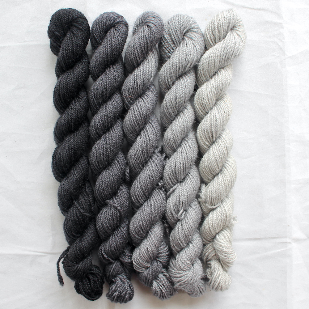 5 grey mini skeins in a gradient from dark to light