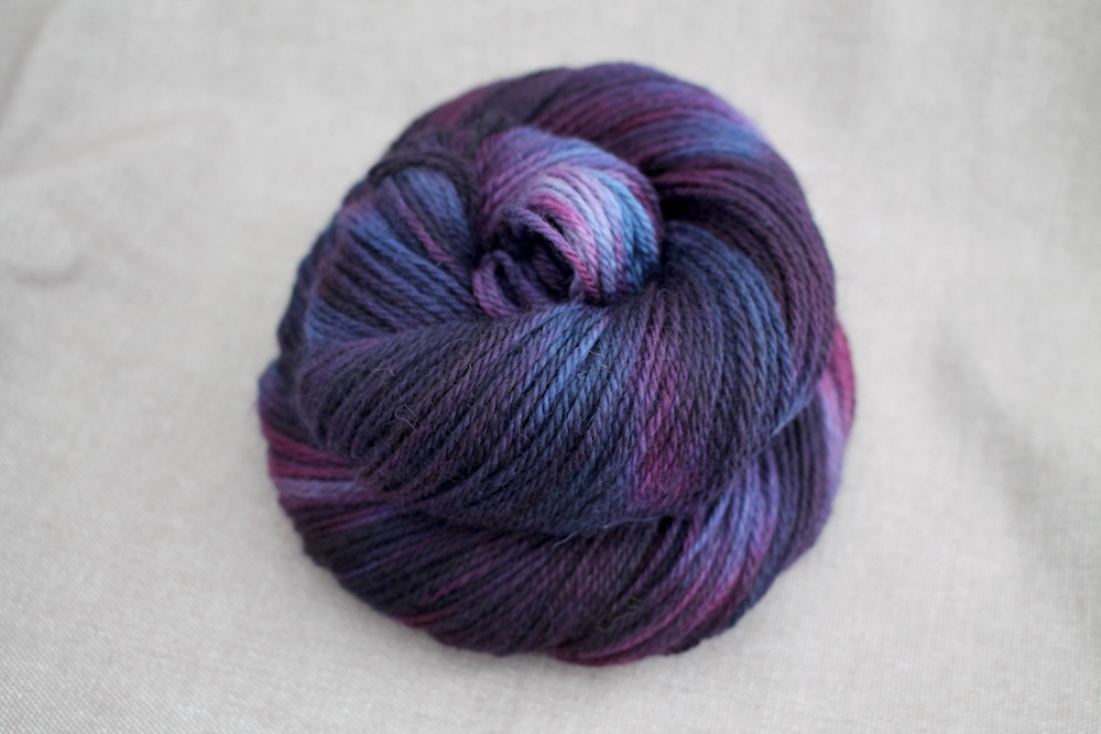 A skein of Lyn DK in the Sloe Gin colourway