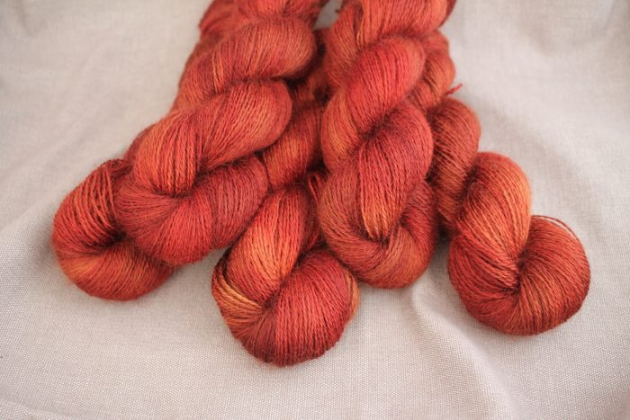 A pile of skeins of Aysgarth in the Roast Chestnut colourway